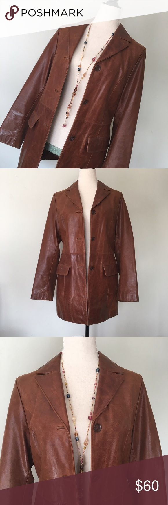 """Congac Leather Jacket Vintage like Congac color leather Jacket in excellent condition. Has 3 front button closure along with 2 front pockets. Lined interior w interior pocket. Small spots on interior lining see last pic. Shoulder to hem measures at approximately 30"""". Arm length pit to wrist is approximately 17"""". Size says small but it could fit a medium. I'd say it was a 6-8. I think it's originally a mans coat but I wore it. Very retro looking✌️ Jackets & Coats"""