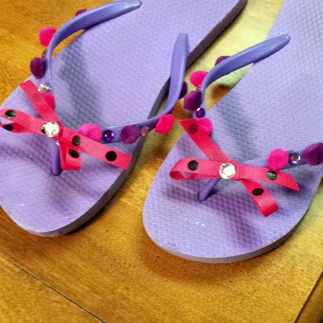 Made old,plain  Old Navy flip flops into cute stylish shoes.very fun craft to do with my momma!!lol