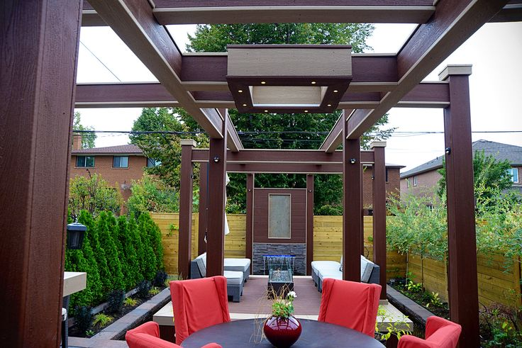 Custom made composite-clad aerial beams supply overhead lighting for the dining area and tie together the zones of the deck. Deck Design by Paul Lafrance Design.