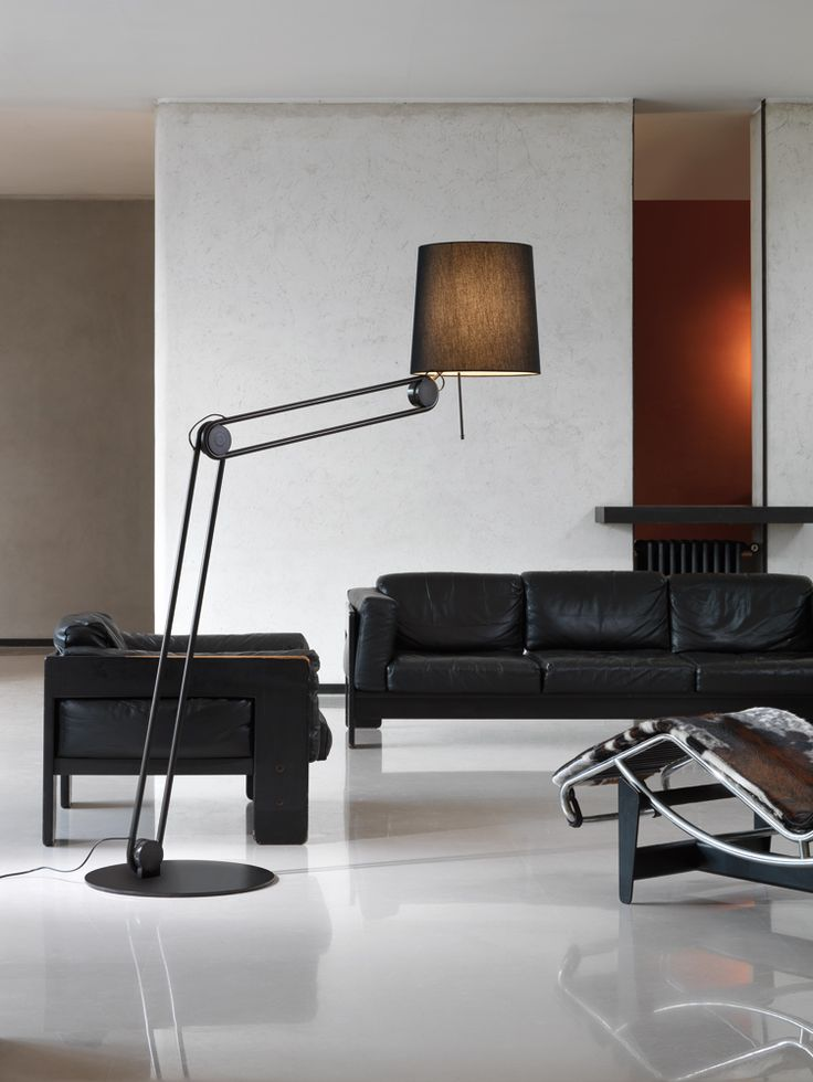 Mecano collection: Free standing lamp for upward and downward diffused lighting. Adjustable metal structure with single or duble joint and base in matt black powder coating or bronze finishing. Black or grey fabric diffuser. Opal PMMA lower screen. Retrofit LED bulbs on request. #andcosta #andcostalighting #andcostalights #lights #lamps #design #interiordesign #madeinitaly #standinglamps #freestandinglamps #lighting