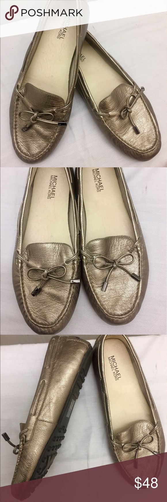 """MICHAEL KORS  """"Daisy"""" Leather Driving Loafer Flats Great looking and Ultra comfortable Pewter leather tone """"DAISY"""" Moccasin loafer flats by Michael KORS.  Round toe with leather lace bow with Pewter tone hardware with """"MK"""" initial detail engrave, hardware logo label at back of heel and comfortable driving loafer style sole in rubber with gripper design. These shoes are in """"Good Condition"""" with little to no signs of wear. Size 10 Michael Kors Shoes Flats & Loafers"""