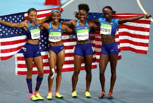 English Gardner, Allyson Felix, Tianna Bartoletta and Tori Bowie of the United States celebrate winning gold in the Women's 4 x 100m Relay Final on Day 14 of the Rio 2016 Olympic Games at the Olympic Stadium on August 19, 2016 in Rio de Janeiro, Brazil.