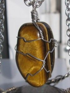 The last 6 hours of the giveaway! Tiger eye stone calcite pendant wire wrapped in sterling silver