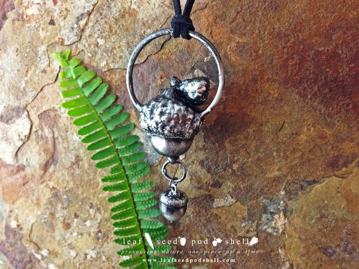 Double acorn pendant in antique sliver.  Available from www.leafseedpodshell.com #leafseedpodshell #leafseedpodshelljewelry #birdhouse #leaves #leaf #acorn #acorns #seeds #pods #shells #copper #electroform #electroforming #electroformed #electroplated #electroplating #crystal #crystals #rustic #plating #jewelry #jewellery #pendant #pendants #handmade #handmadejewelry