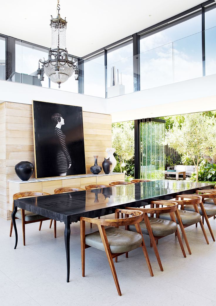 Dining Space With White Floors Black Table Wooden Chairs Leather Cushions Light