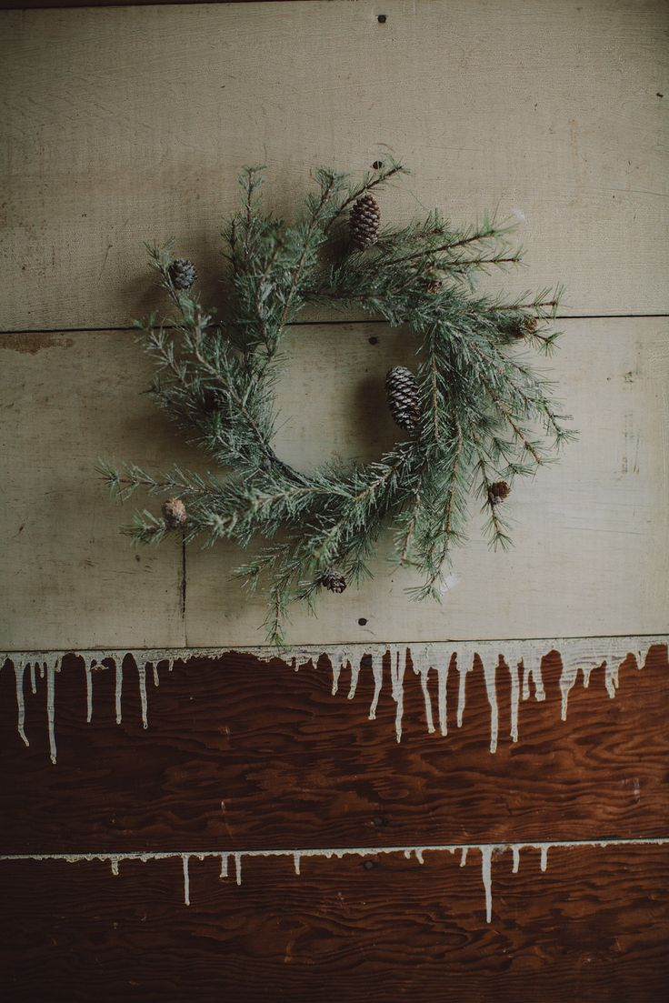pretty wreath and love the paint dripped board wall!!: