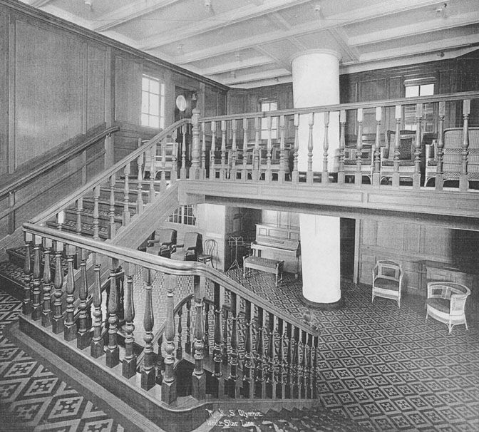 Titanic's second class pianos and stairway. Notice the piano, bottom floor, left.