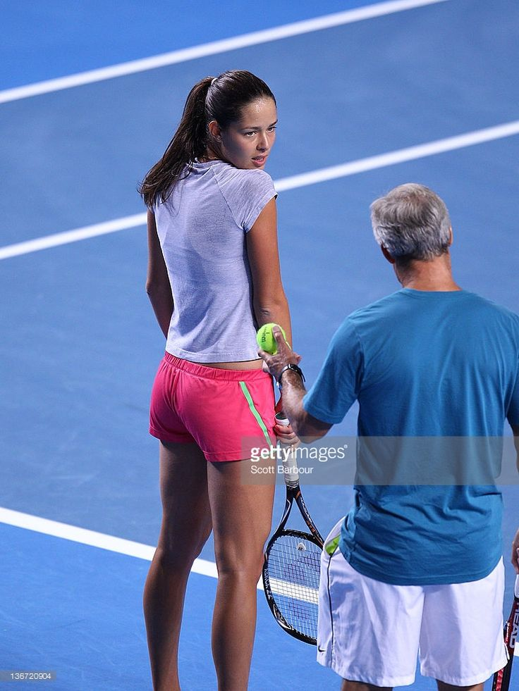 Ana Ivanovic of Serbia listens to her coach Nigel Sears during a practice session prior to the 2012 Australian Open at Rod Laver Arena on January 11, 2012 in Melbourne, Australia.