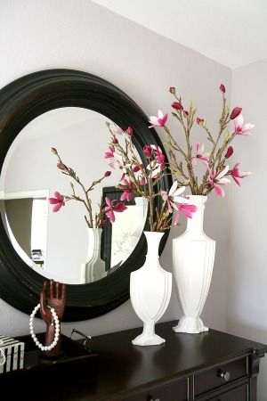 Bedroom mirror and vases.