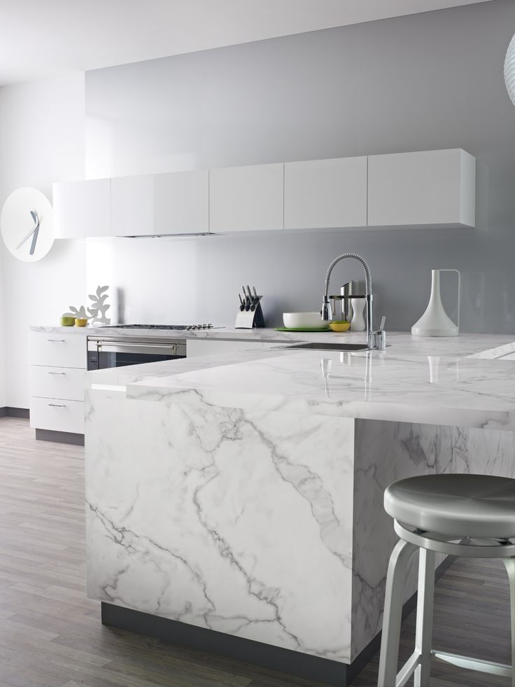 Impressive, grand and affordable – Formica® 180fx® 3460-46 Calacatta Marble is beautiful in white, modern kitchens. Click through to get your free sample