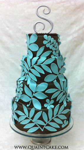 """I can totally see this as my sister Sara's wedding cake. Capital """"S"""" on top with no love for the groom! Teal bright blue Hawaiian-style leaf pattern with that cool peeling-off effect. Chocolate. Perfect!"""