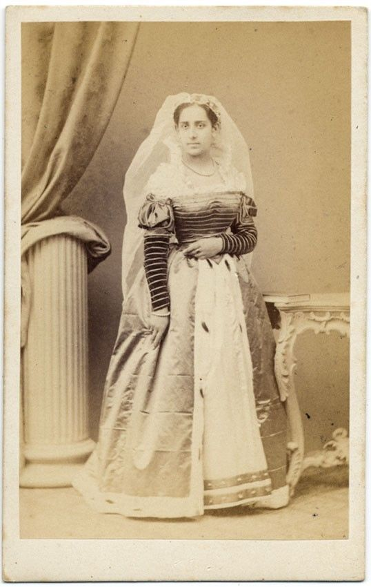 "1860s CDV of a woman in Renaissance fancy dress. Penciled on back is ""Duchesse Sforza,"" and it does look somewhat like an earlier painting of the Duchess (who was English-born but lived in Italy with her husband), although she would have been 42 in 1860. Backstamp is Michele Mang & C., Roma; he appears to have been active 1860-80ish."
