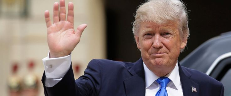 US President Donald Trump waves as he arrives for a meeting with French President Emmanuel Macron at the Elysee Palace in Paris, Thursday, July 13, 2017. Trump will be the parades guest of honor to commemorate the 100th anniversary of the U.S. entry
