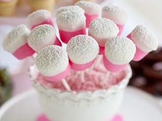 Marshmallows dipped in pink and then in sprinkles