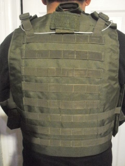 Quick Release Chest Rig with Triple Magazine Molle Pouch for more follow link... http://stores.airsoftlegion.com/tactical-quick-release-chest-rig-in-od/