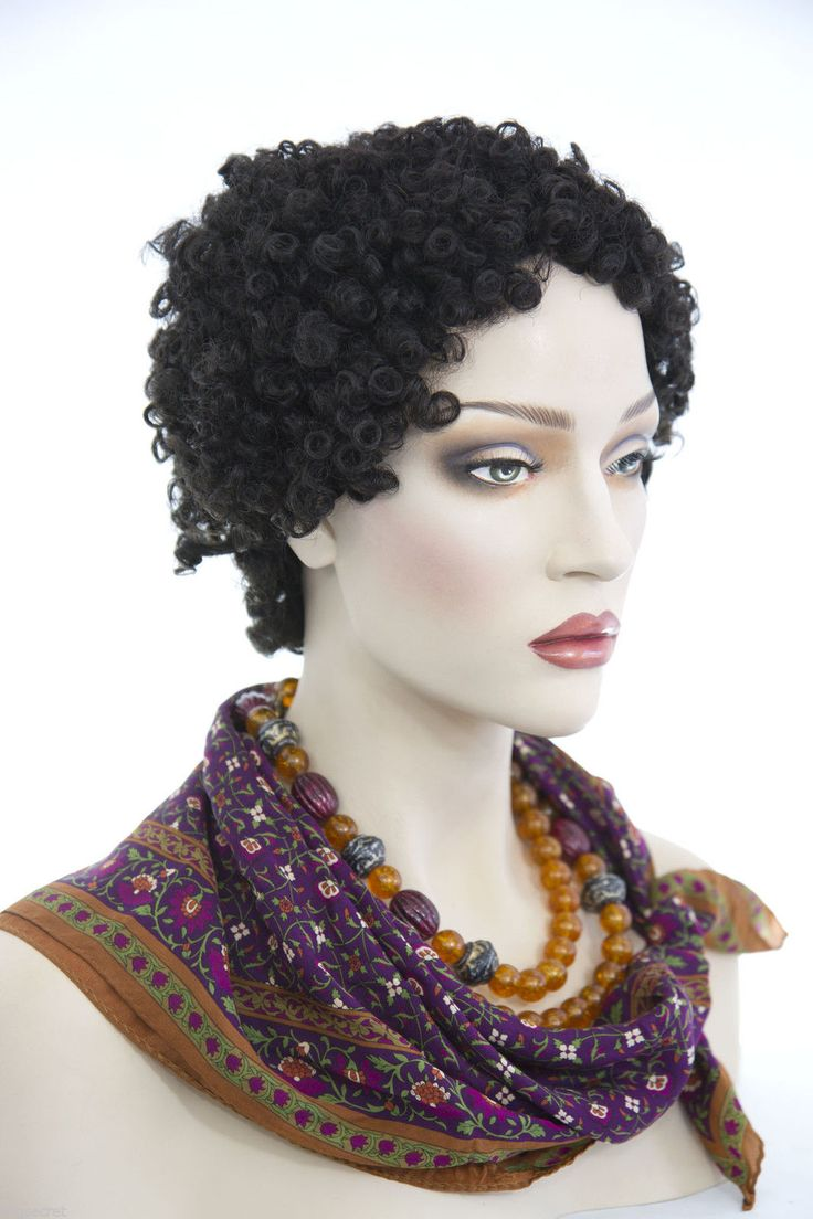 Small tight ringlets are featured in this chic short afro style wig. The hair is…