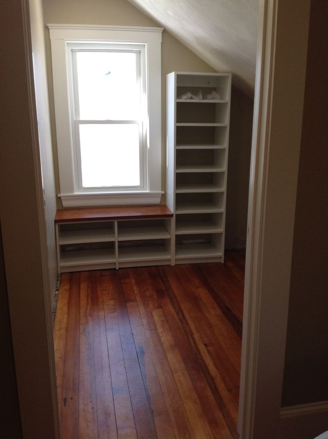 Attic closet with window seat and tall cabinet