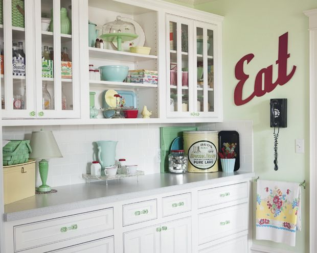 I love the pale green knobs and drawer pulls.  Such a pretty cottage kitchen (from Meadowbrook Farm)
