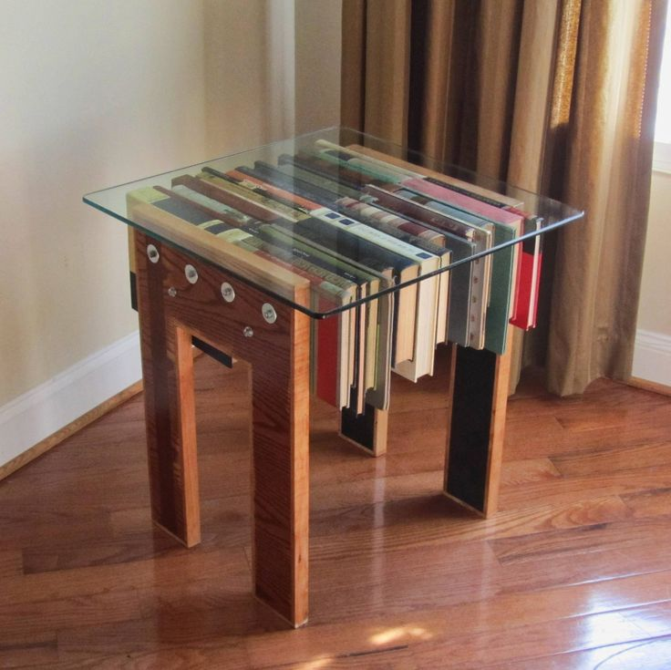 Upcycle table...... Library sale books are about a dime a piece. Glass would be the most expensive part of this project :)