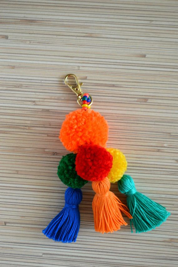 Pom pom keychain Pom pom bag charm Tassel keychain Purse Charm Boho keychain Handbag charm Tassel clip Pompom key chain Neon pink Mint Colorful bag charm / key chain made of hand crafted pom poms and tassels. Available in 4 colors: hot pink, purple, mint and blue. One size.