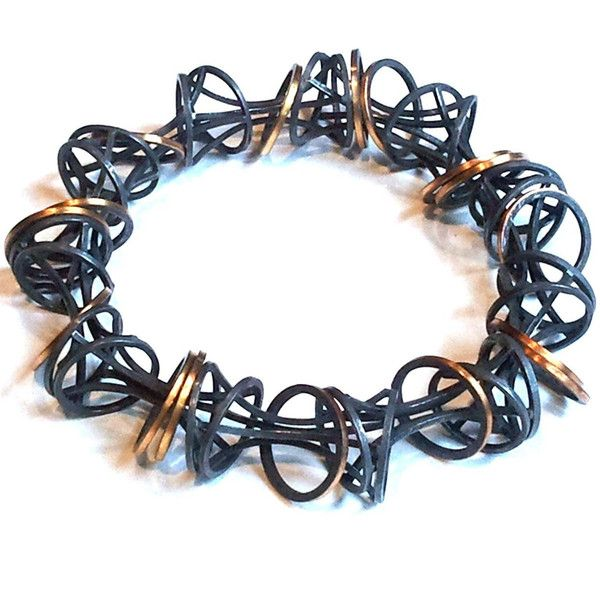 Verve Bracelet hand formed and fabricated in blackened sterling silver and 22k gold.by Gina Pankowski