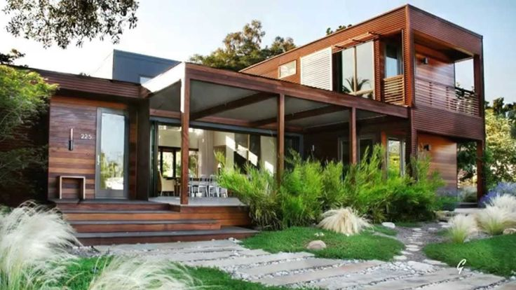 Home Design Exterior Brown Wood Framed Shipping Container Home Luxury Design With Glass Combine Feat Some Small Green Plant Sustaining Classy Style In A House Converted From Shipping Containers Decoration & Home Design & Architecture Sustaining Classy Style In A House Converted From Shipping Containers
