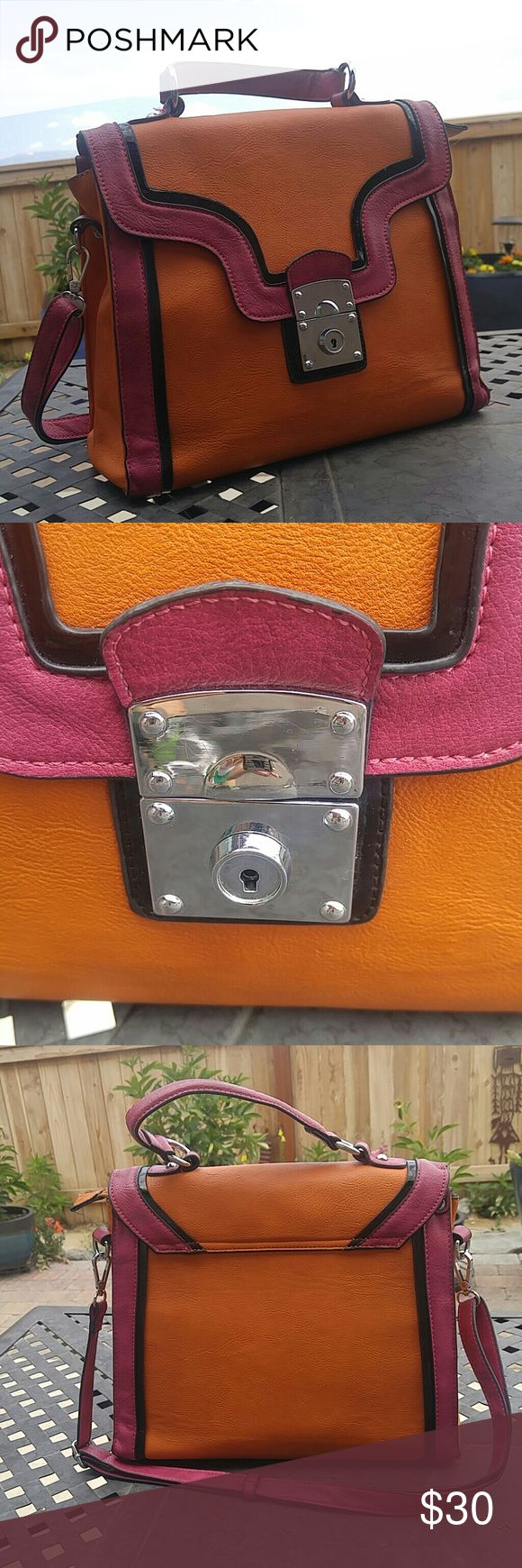 melie bianco purse handbag shoulder bag Stylish designer cruelty free vegan leather purse. Mauve-pink and burnt orange color with black trim and silver fasteners. A lock style buckle. Removable and adjustable shoulder strap. Polka dot liner.  High quality material. Used but in excellent shape. Melie Bianco Bags Shoulder Bags