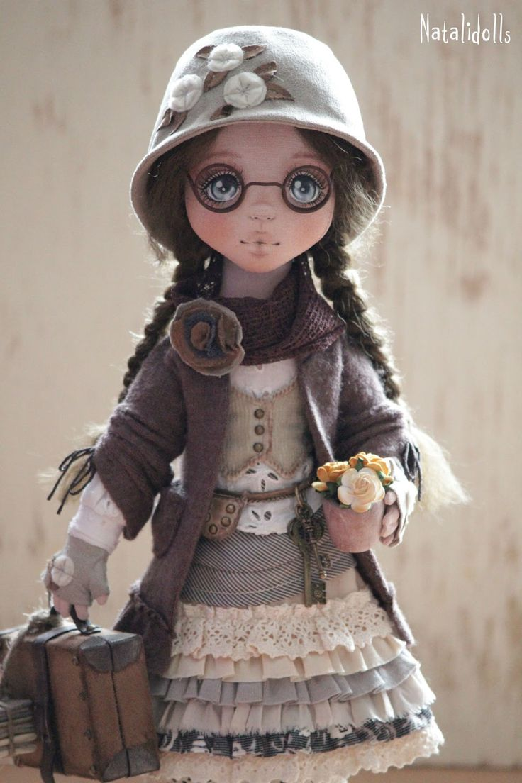 Cloth doll with lovely painted face by Natalidoll