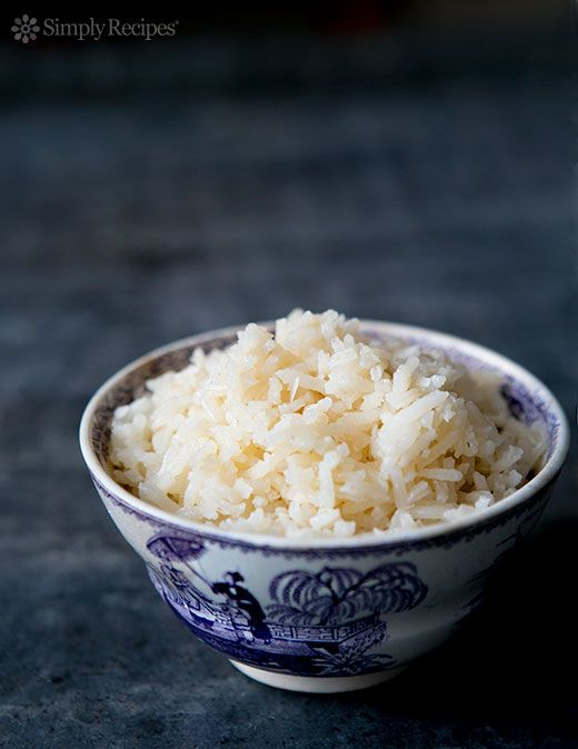 Aromatic Coconut Rice, a savory Indian-style coconut rice, with onions, garlic, grated coconut, cardamom, cloves, and cinnamon. Perfect with Indian food! On SimplyRecipes.com