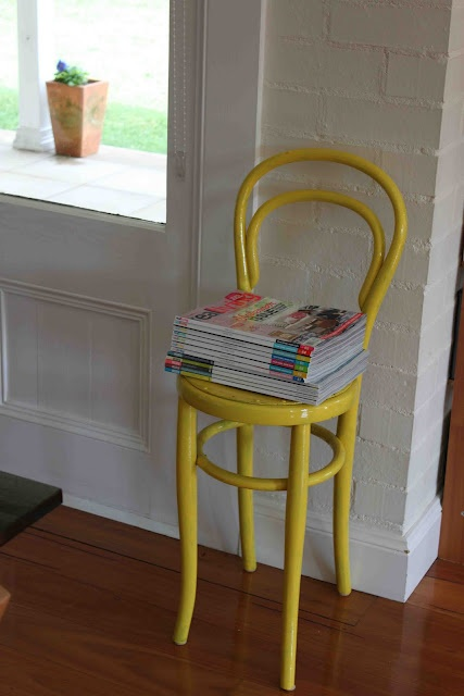 yellow. chair to hold books.