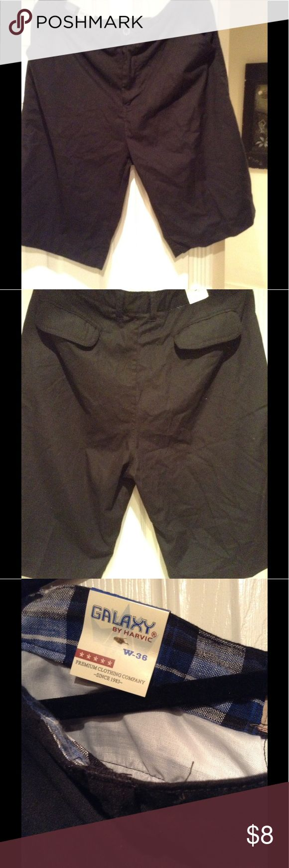 Men's chino shorts by Galaxy NWT Brand new with tags men's black walking shorts. Flap back pockets. My husband received as a gift. Wrong size. galaxy Shorts