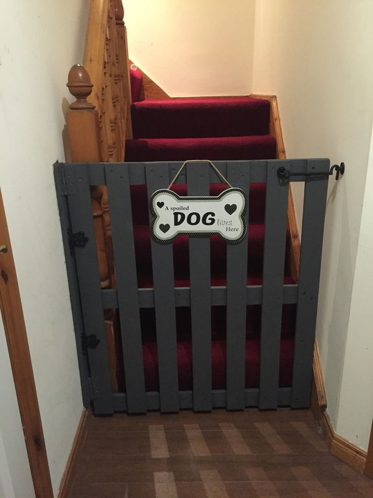 Hand made stair gate from a wooden pallet... A child's safety gate was too low & the dogs jumped it! Not this one tho. :-)