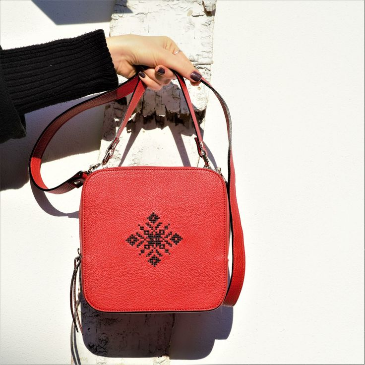 Iutta Magpie bag with signature black embroidery on red leather. Can be worn cross-body. The motif is traditional Romanian. #romania #leathercraft