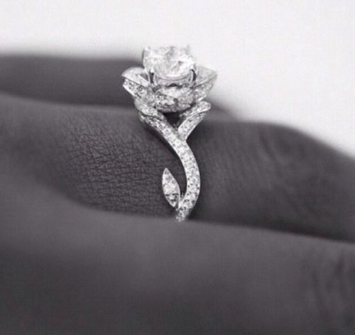 "Absolutely the most beautiful wedding ring I've ever seen I'm in love! Love the ""rose"" and love the make"
