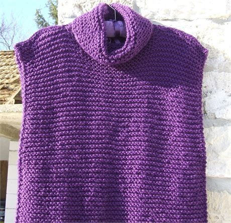 Knitted sleeveless tunic in garter stitch with cowl neckline. The back of this tunic is longer than the front and the side seams are sewn up on the wrong side giving an overlock look. Knitted in a rich deep purple colour in a chunky soft yarn.  This would fit a size small/medium - all measurements are given below - and would look good with leggings or skinny jeans and a jumper / sweater underneath  Measurements - Front length from bottom of neck - 22 (56 cm) Back length from bottom of neck…