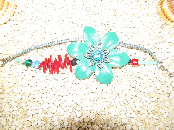 Handmade bracelet (1 pc)  Made with leather and metal flower, leather cords in metal basket cord, gemstones and glass beads.