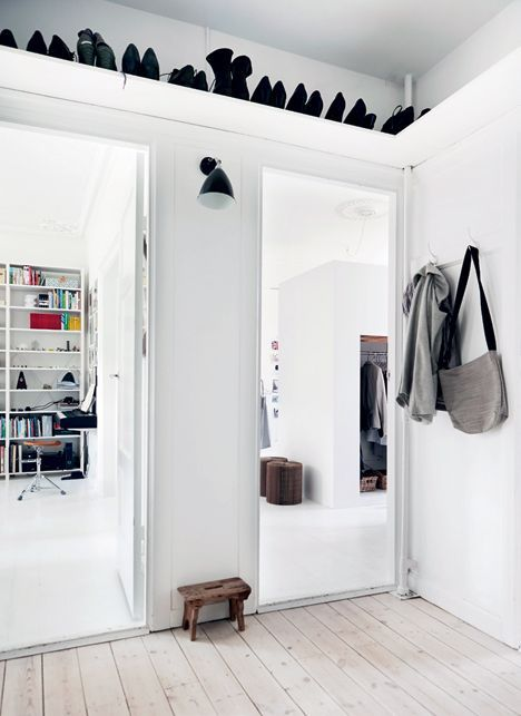 Scandinavian shoe shelf over the entryway