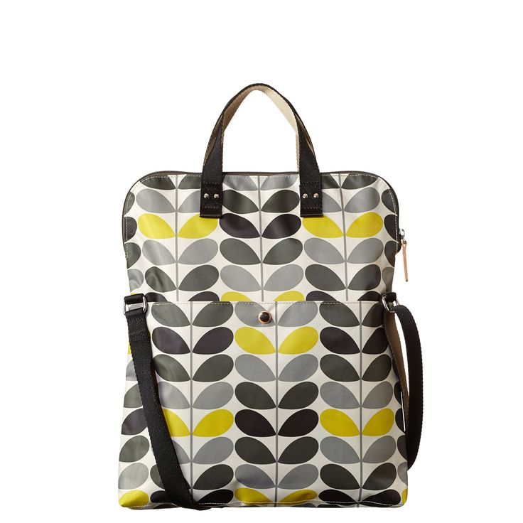 Orla Kiely: Large Tonal Stem printed fabric tote bag with zip closure. Tote bag folds over to be worn as a cross-body style with long adjustable webbing strap (max 130cm). Double sided webbing handles and large pocket on back of bag. Silver coloured hardware. Inside details include large patch pocket with small leather logo card holder and contrast coloured binding. This style is unlined.