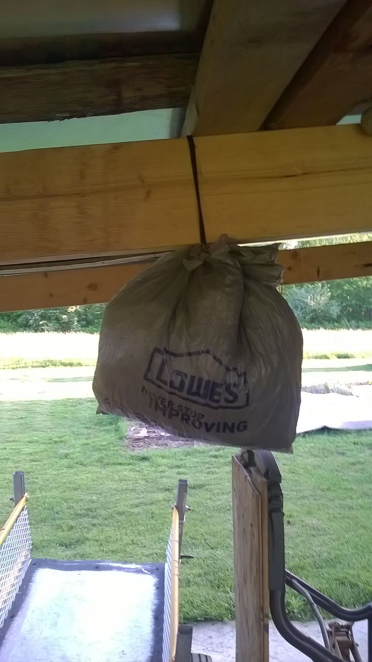"Want to get rid of wood bees?  Put up a ""hornet's nest""  (grey bag filled with plastic bags) Hornets are a natural enemy and wood boring bees will not trespass.   This really works."