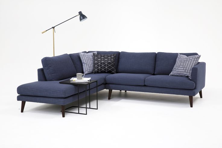 The Hugo corner sofa with chaise, floor lamp and Myron side table from Lounge Lovers.