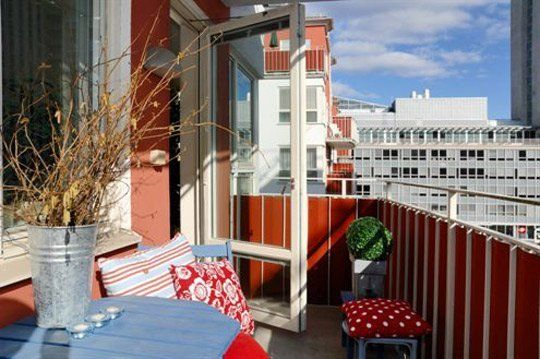 Small Balcony Idea: Line It With Fabric.  Great idea for that porch with that view!