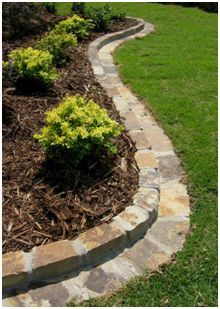 Stone mow strip will keep grass out of flower beds but could also be used to keep gravel out of grass along a driveway.