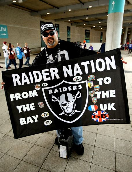 A Raider fan arrives at the stadium prior to kickoff during the NFL match between the Oakland Raiders and the Miami Dolphins at Wembley Stadium on September 28, 2014 in London, England.