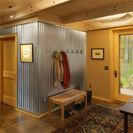 sheet metal wall covering. simple way to dress up a garage mudroom with sturdy materials that stylishly designate the area!