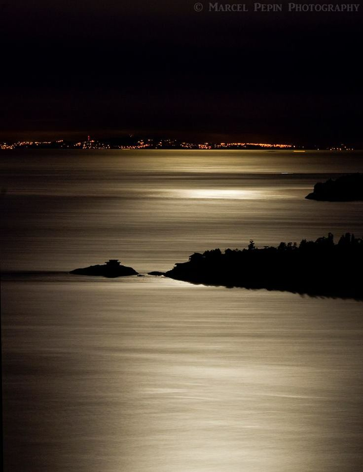 Moon reflecting on the Salish Sea Nanaimo, on Vancouver Island, BC in the far background