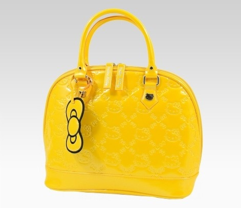 Hello Kitty Yellow Handbag: Embossed  Loungefly for Hello Kitty - Head out with this fashionable Hello Kitty yellow embossed Loungefly designed handbag. This chic and must-have handbag has 2 inner pockets and 1 zipper pocket for additional storage. It also comes with a yellow Hello Kitty bow bag tag to complete the look. All this Hello Kitty handbag needs is lovely and fashionable owner like me :)