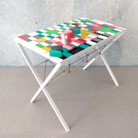 Handmade in Berlin, Domino Tray & Butler is a collaboration between EXHIBIT, Thomas Pausz and Neue Tische. Domino Table Eat, play, build and tumble. Handmade in Berlin using recycled dominos, the table top pieces come in a variety of colours and can be built and arranged to suit your mood.
