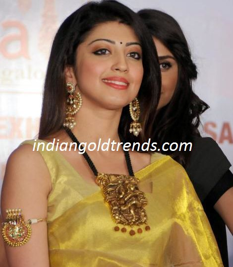 Latest Indian Gold and Diamond Jewellery Designs: Praneetha in big nakshi pendant and earrings