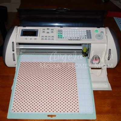 She used her cricut to cut fabric for iron on shirts! :)