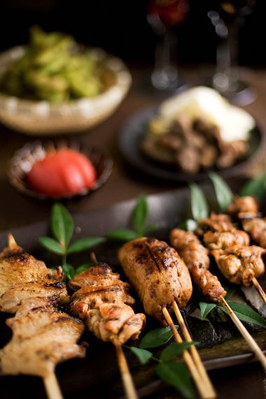 Traditional Japanese dish: yakitori  (small pieces of chicken meat, liver and vegetables skewered on a bamboo stick)